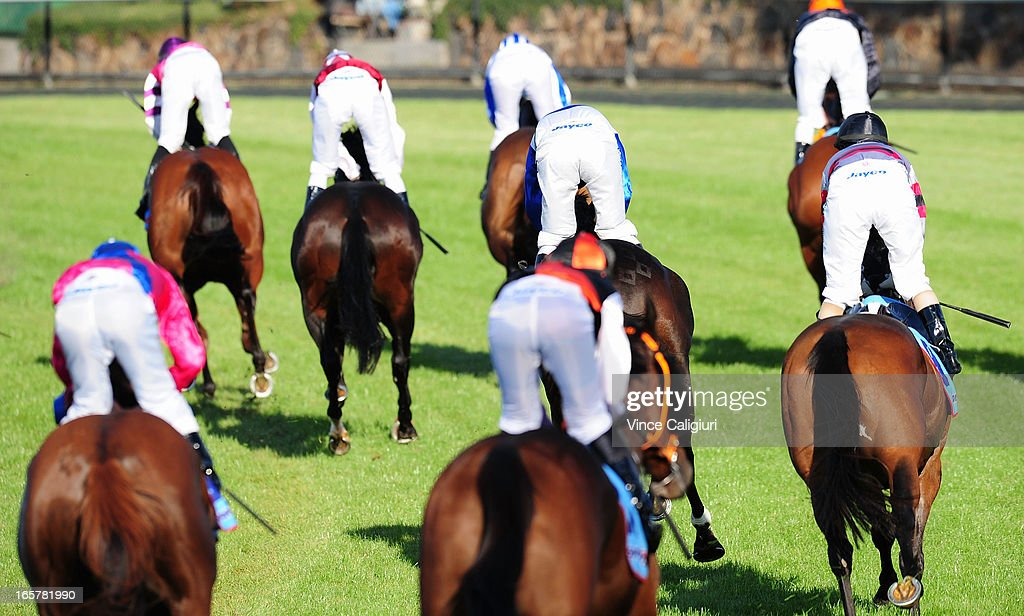 Jockeys after crossing the line in the Epworth Radiation Oncology Handicap during Melbourne racing at Moonee Valley Racecourse on April 6, 2013 in Melbourne, Australia.