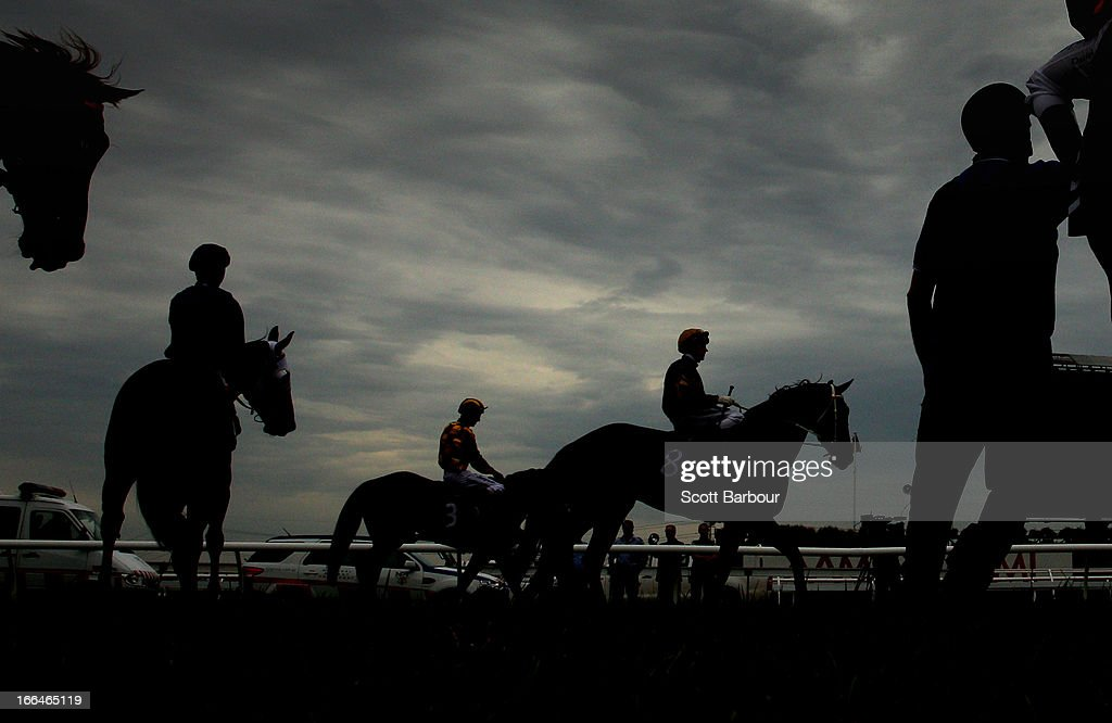 Jockeys and horses are led into the barrier stalls before race 4 the Galilee Series Final during Melbourne Racing at Flemington Racecourse on April 13, 2013 in Melbourne, Australia.