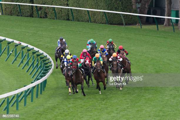 Jockeys and horses turn into home straight during the Race 9 Shakotan Tokubetsu at Sapporo Racecourse on August 26 2017 in Sapporo Hokkaido Japan