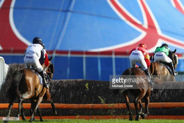 Jockeys approach a fence in front of a colourful marquee at Worcester Racecourse on October 17 2017 in Worcester England