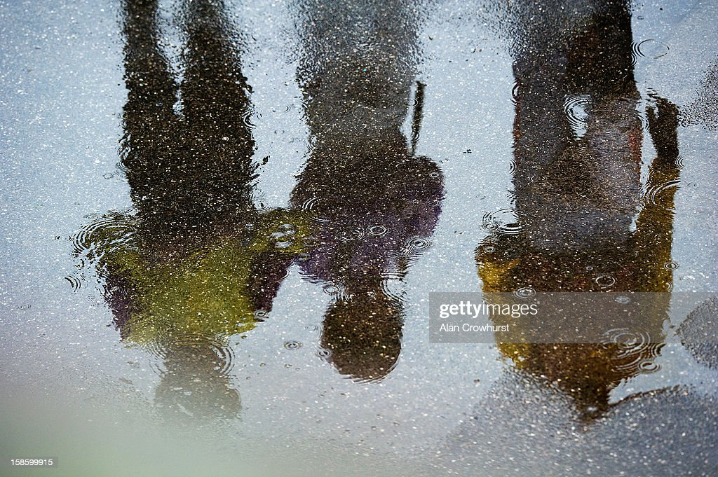 Jockeys are reflected in puddles on a wet day at Lingfield racecourse on December 20, 2012 in Lingfield, England.