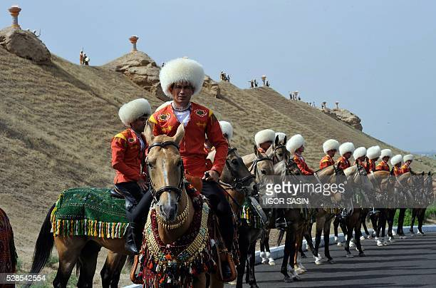 Jockeys attend the starting ceremony of a 500day nationwide horse race at the historical site of Nisa just outside Ashgabat on May 5 2016 in...