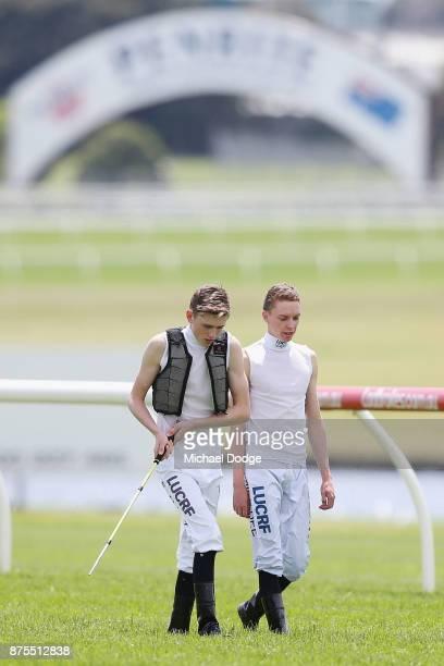 Jockeys Ben Allen and Mick Dee test the surface during Melbourne Racing at Sandown Lakeside on November 18 2017 in Melbourne Australia