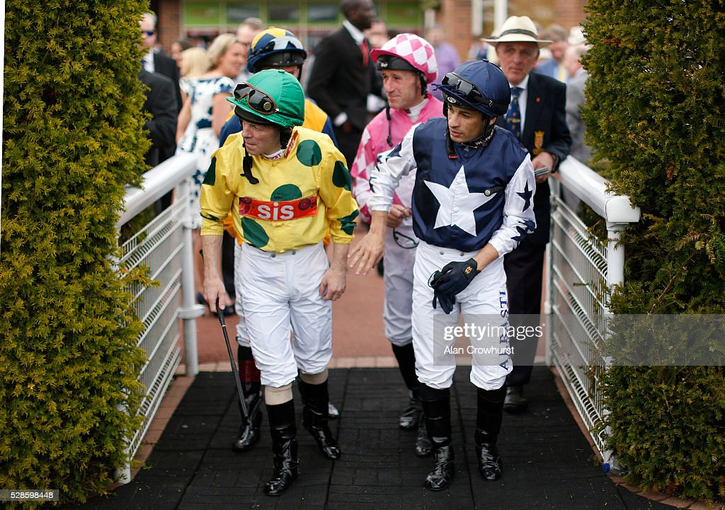 Jockeys check they're clear to cross into the parade ring at Chester racecourse on May 6, 2016 in Chester, England.