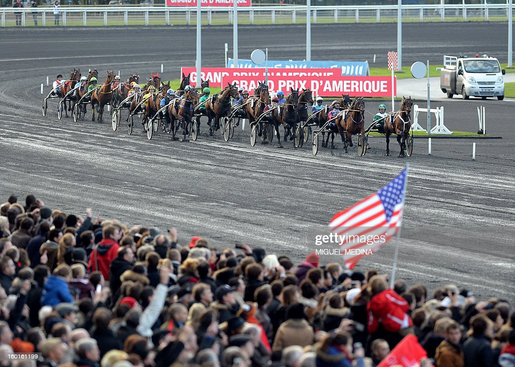 Jockeys compete during the 92nd Grand Prix d'Amerique, the most prestigious trotting race in Europe, on January 27, 2013 at the Vincennes racetrack, east of Paris. The race was created in 1920 to honor US soldiers who fought during World War I. AFP PHOTO / MIGUEL MEDINA
