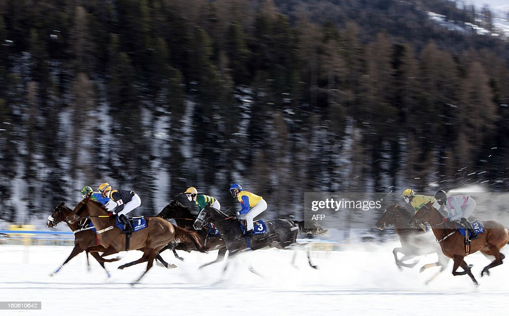 Jockeys compete in the White Turf horse racing event in St. Moritz on February 3, 2013. The races are held on the frozen lake of the Swiss mountain resort. HEGER