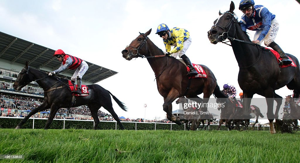 Jockey's Graham Lee riding Mistiroc Callum Shepherd riding Only Orsenfoolsies and Adam Kirby riding Penhill cross the line during the Betfred...