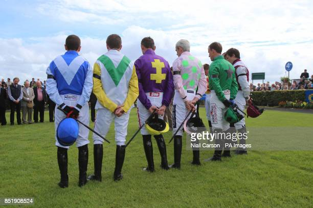 Jockeys hold a minutes silence in honour of RTE broadcaster Colm Murray on day two of the 2013 Galway Summer Festival who died from Motor Neuron...