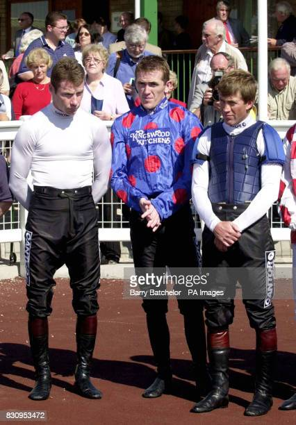 Jockeys including Mick Fitzgerald Tony McCoy and Carl Llewellyn during the prayers and silence before the first race at Hereford Racecourse *...