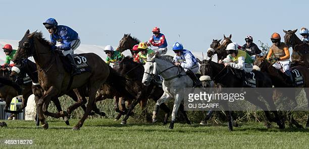 Jockeys jump The Chair including the eventual winner jockey Leighton Aspell riding 'Many Clouds' in the Grand National race on the final day of the...