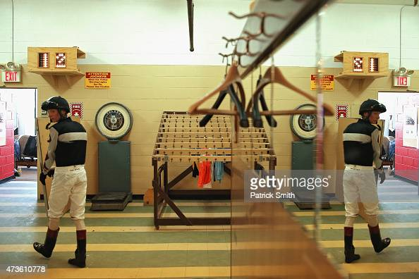 Jockeys leave the jockeys room for a race prior to the 140th running of the Preakness Stakes at Pimlico Race Course on May 16 2015 in Baltimore...