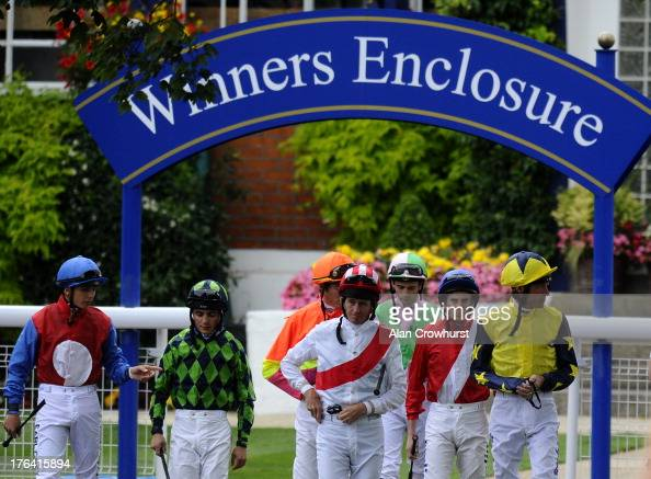 Jockeys leave the weighing room and make their way to the parade ring at Windsor racecourse on August 12 2013 in Windsor England