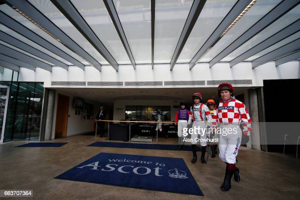 Jockeys leave the weighing room at Ascot Racecourse on April 2 2017 in Ascot England