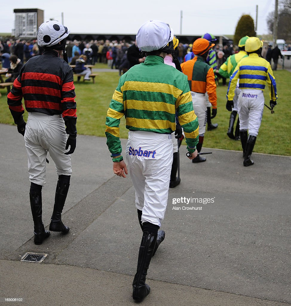 Jockeys leave the weighing room at Huntingdon racecourse on March 03, 2013 in Huntingdon, England.