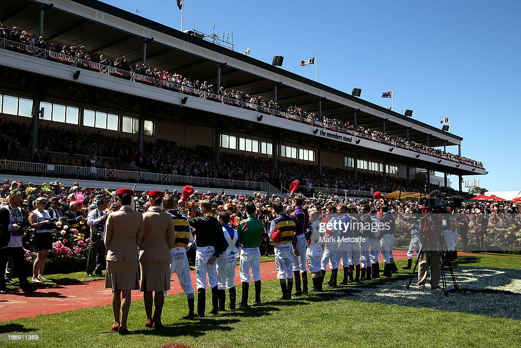 Jockeys line up for the National Anthem ahead of the Emirates Melbourne Cup during Melbourne Cup Day at Flemington Racecourse on November 5, 2013 in Melbourne, Australia.