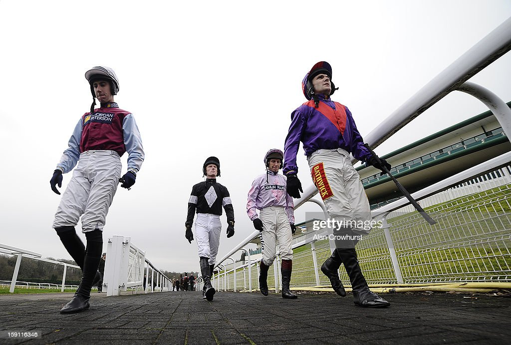Jockeys make their way into the parade ring at Chepstow racecourse on January 08, 2013 in Chepstow, Wales.