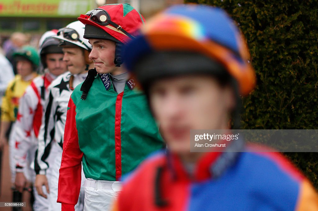 Jockeys make their way into the parade ring at Chester racecourse on May 6, 2016 in Chester, England.