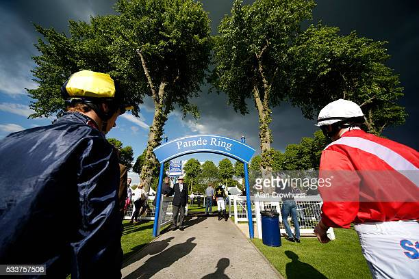 Jockeys make their way into the parade ring at Windsor Racecourse on May 23 2016 in Windsor England