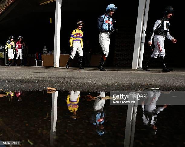 Jockeys make their way to the parade ring at Kempton Park on October 16 2016 in Sunbury England