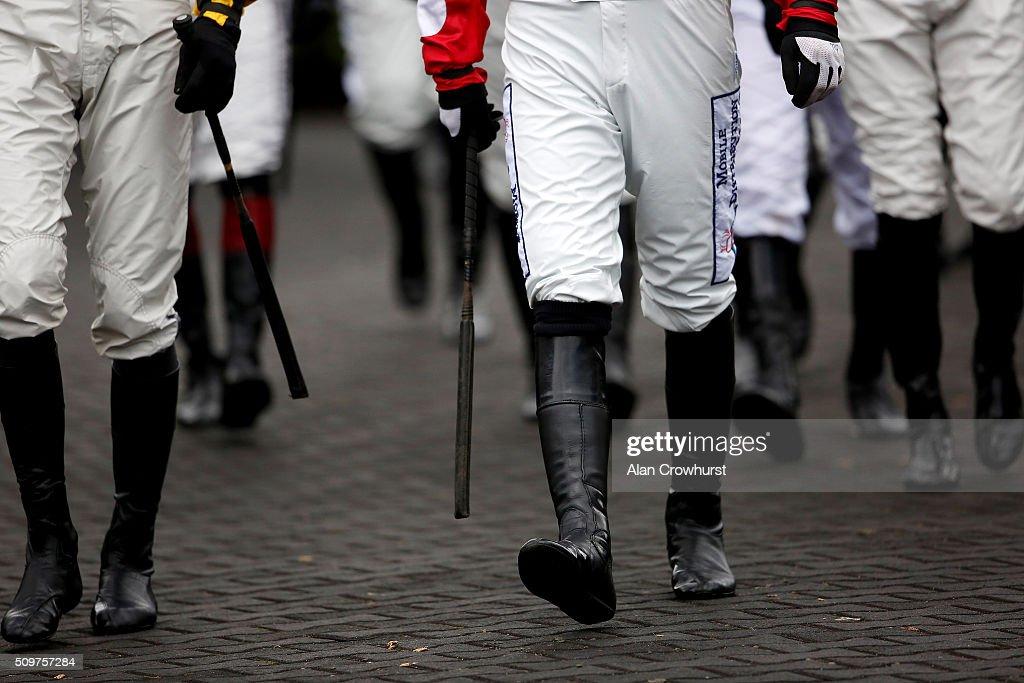 Jockeys make their way to the parade ring at Kempton Park racecourse on February 12, 2016 in Sunbury, England.