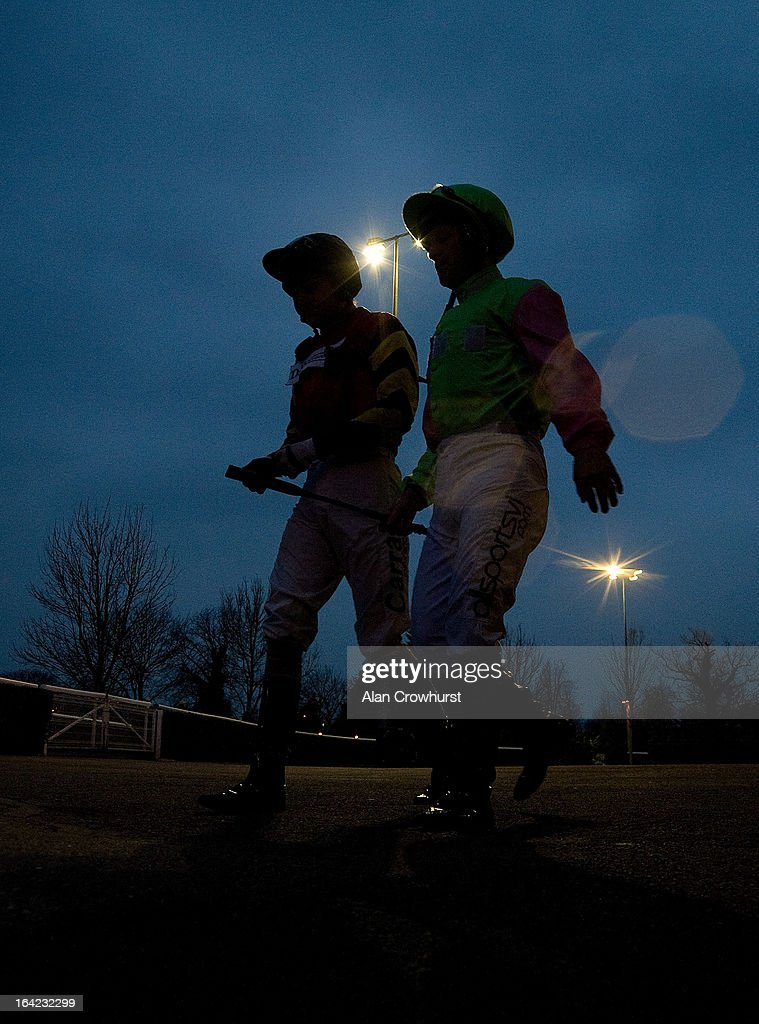 Jockeys make their way to the parade ring at Kempton racecourse on March 21, 2013 in Sunbury, England.