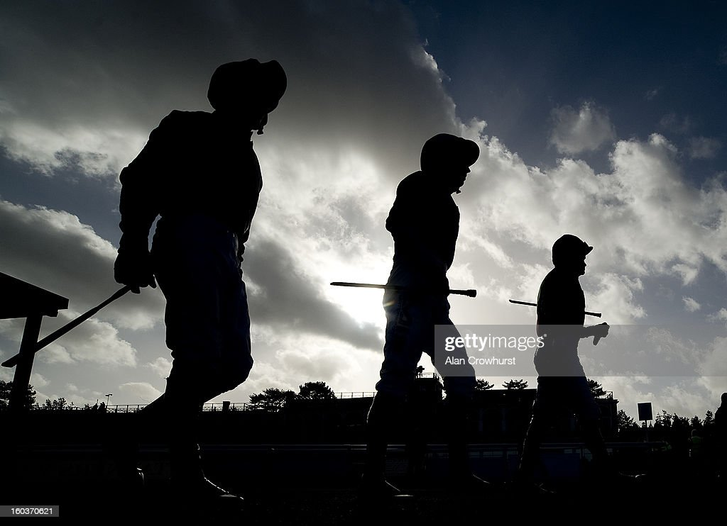 Jockeys make their way to the parade ring at Ludlow racecourse on January 30, 2013 in Ludlow, England.