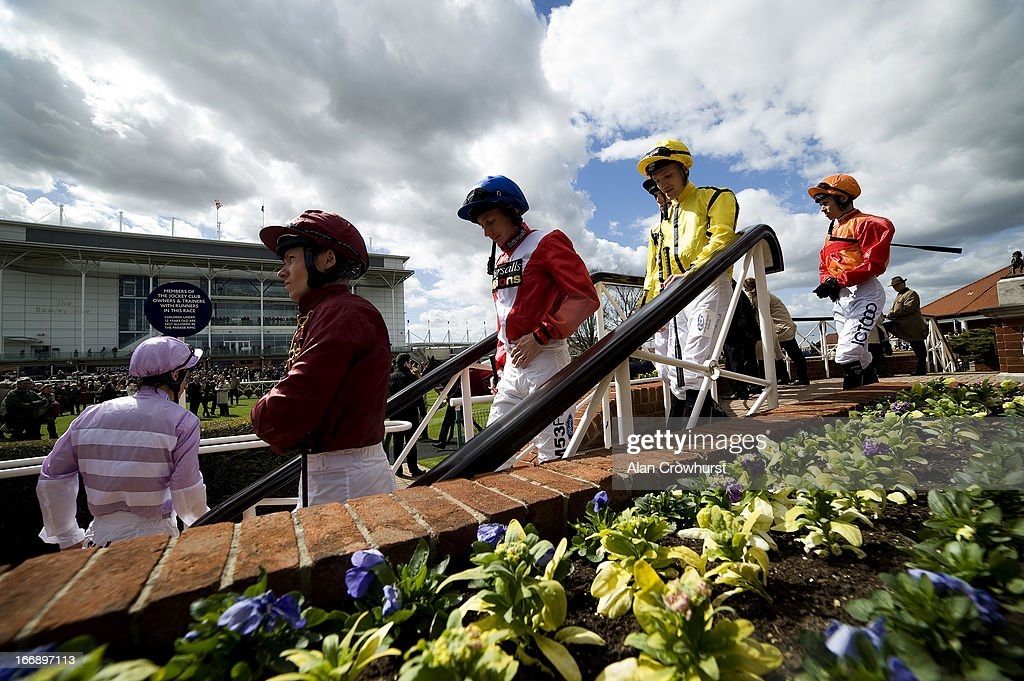 Jockeys make their way to the parade ring at Newmarket racecourse on April 18, 2013 in Newmarket, England.