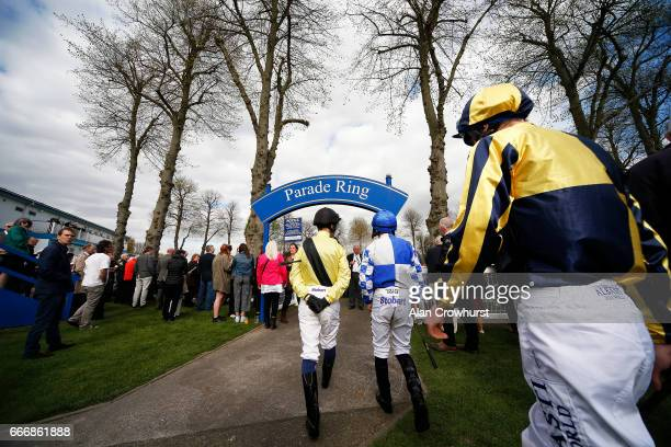 Jockeys make their way to the parade ring at Windsor Racecourse on April 10 2017 in Windsor England