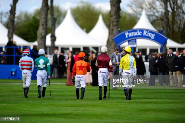Jockeys make their way to the parade ring for the first race at Windsor racecourse on April 29 2013 in Windsor England
