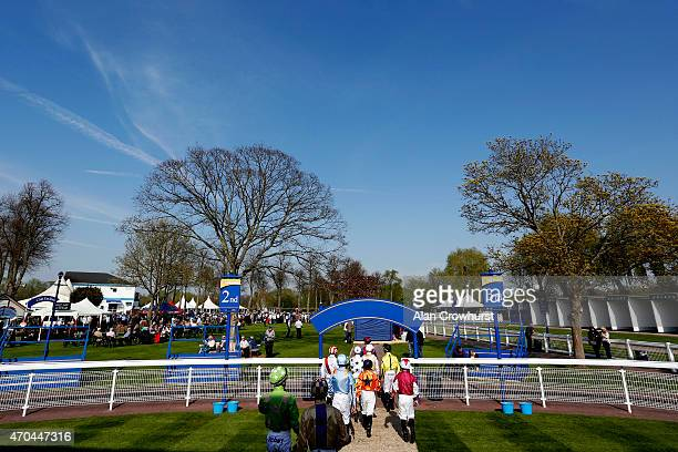 Jockeys make their way to the parade ring for the opening race at Windsor racecourse on April 20 2015 in Windsor England