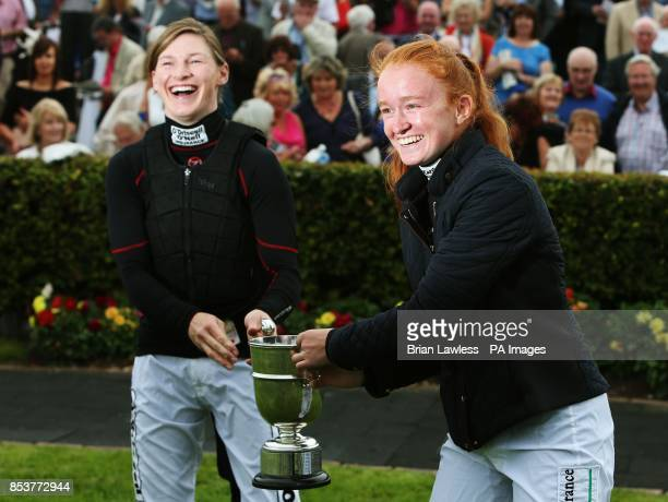 Jockeys Nina Carberry and Jane Mangan after they were presented with the Mary Hyde cup having tied for the leading lady rider for the National Hunt...