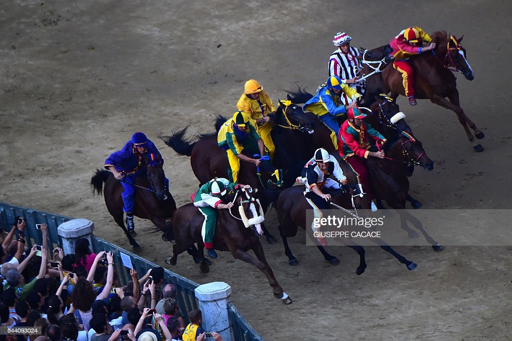 Jockeys of different Contrada compete during the proof-race of the historical Italian horse race of the Palio of Siena on July 1, 2016 in Siena. / AFP / GIUSEPPE