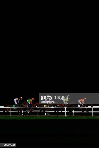 Jockeys race in the Download Free The Racing Post iPhone App Claiming Stakes at Kempton Park on January 12 2011 in Sunbury England