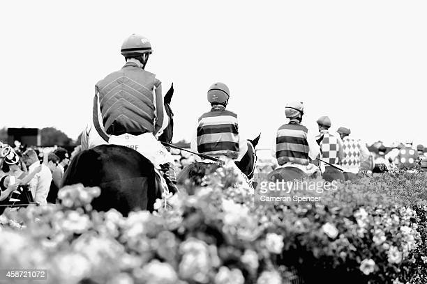 Jockeys return to the mounting yard after a race on Melbourne Cup Day at Flemington Racecourse on November 4 2014 in Melbourne Australia