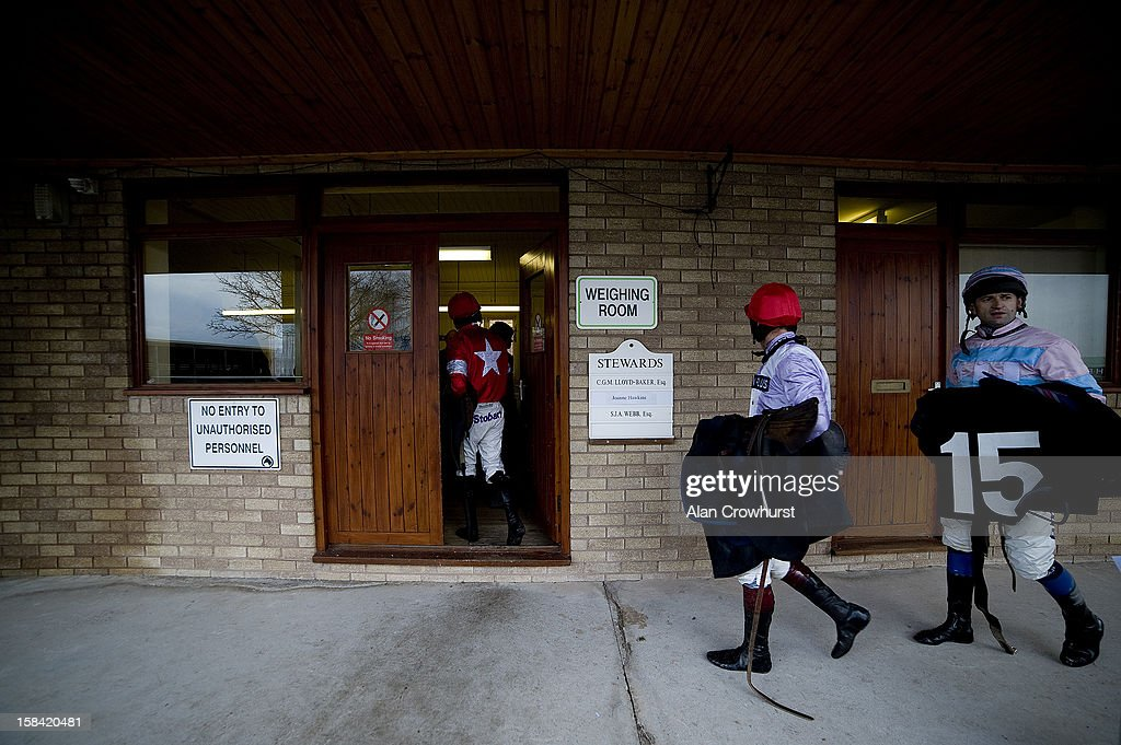 Jockeys return to the weighing room during the last meeting to be held at Hereford racecourse after 241 years of racing on December 16, 2012 in Hereford, England.