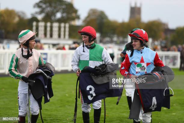 Jockeys Richard Johnson Ciaran Gethings and Brian Hughes head to the weighing room following the fourth race at Worcester Racecourse on October 17...