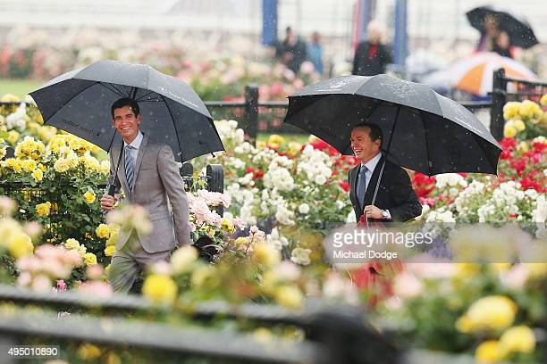 Jockeys Steven Arnold and Stephen Baster arrive on Derby Day at Flemington Racecourse on October 31 2015 in Melbourne Australia