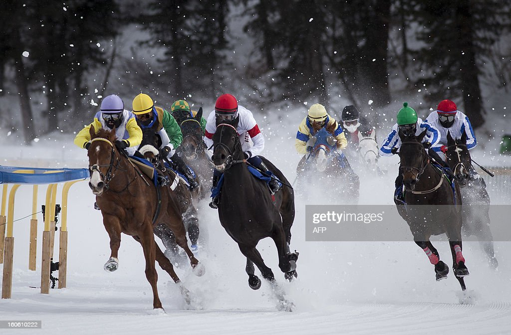 Jockeys take the last turn during the White Turf horse racing event in St. Moritz on February 2, 2013. The races are held on the frozen lake of the Swiss mountain resort. HEGER