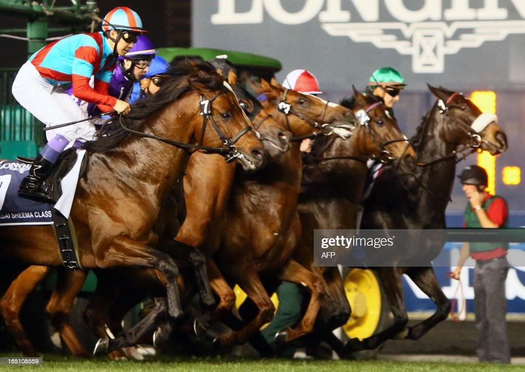 Jockeys take the start of the Dubai Sheema Classic part of the Dubai World Cup meet, the world's richest race, at Meydan race track in Dubai on March 30, 2013. AFP PHOTO/MARWAN NAAMANI