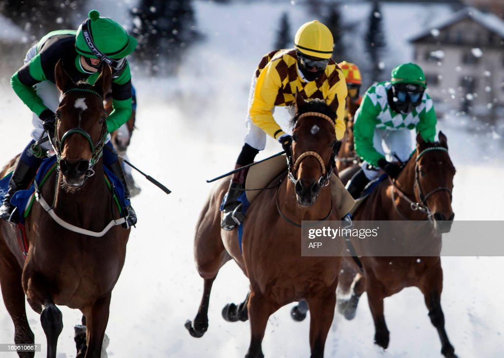Jockeys take the start of the White Turf horse racing event in St. Moritz on February 3, 2013. The races are held on the frozen lake of the Swiss mountain resort. HEGER