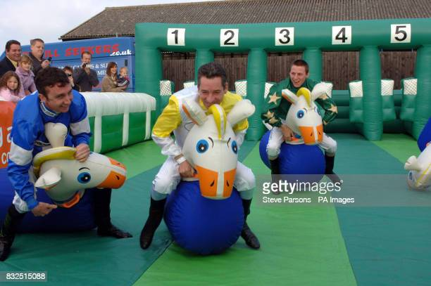 Jockeys Tony Culhane Michael Hills and Eddie Ahern raise money for the Brooke overseas equine welfare charity by taking part in a spacehopper race on...