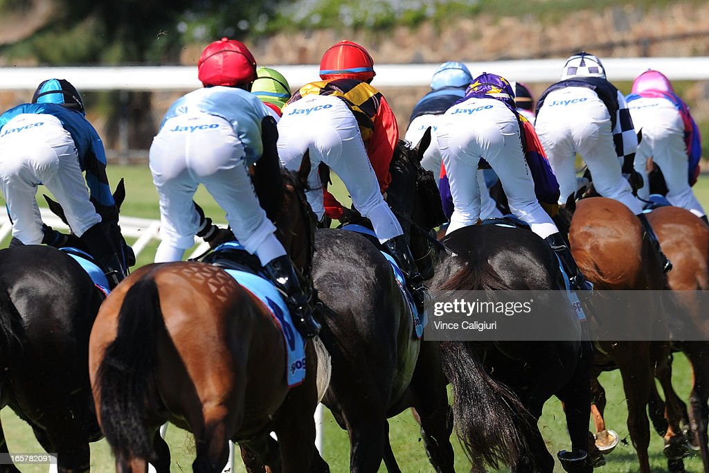 Jockeys turn out of the straight in the Medownick Laser Eye Surgery Handicap during Melbourne racing at Moonee Valley Racecourse on April 6, 2013 in Melbourne, Australia.