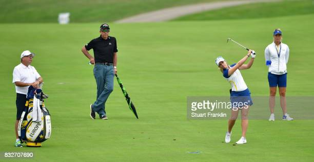 Jodi Ewart Shadoff of Team Europe plays a shot whilst being watched by coach David Leadbetter and Suzann Pettersen during practice for The Solheim...