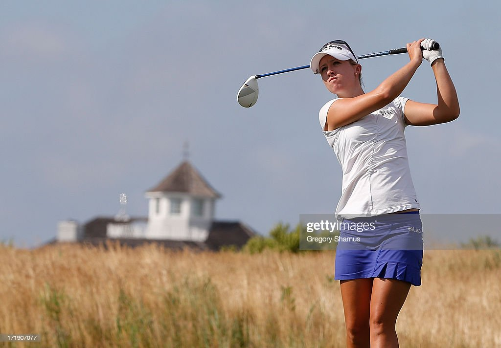 Jodi Ewart Shadoff watches her tee shot on the 15th hole during the third round of the 2013 U.S. Women's Open at Sebonack Golf Club on June 29, 2013 in Southampton, New York.