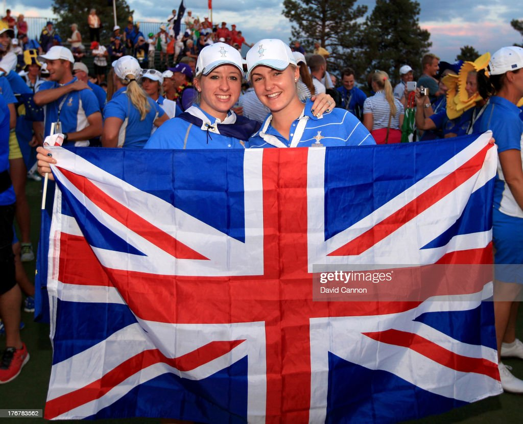 Jodi Ewart-Shadoff and Charley Hull the English rookies of the European Team hold the Union Jack after they had clinched the first ever victory on American soil during the final day singles matches in the 2013 Solheim Cup at The Colorado Golf Club on August 18, 2013 in Parker, Colorado.