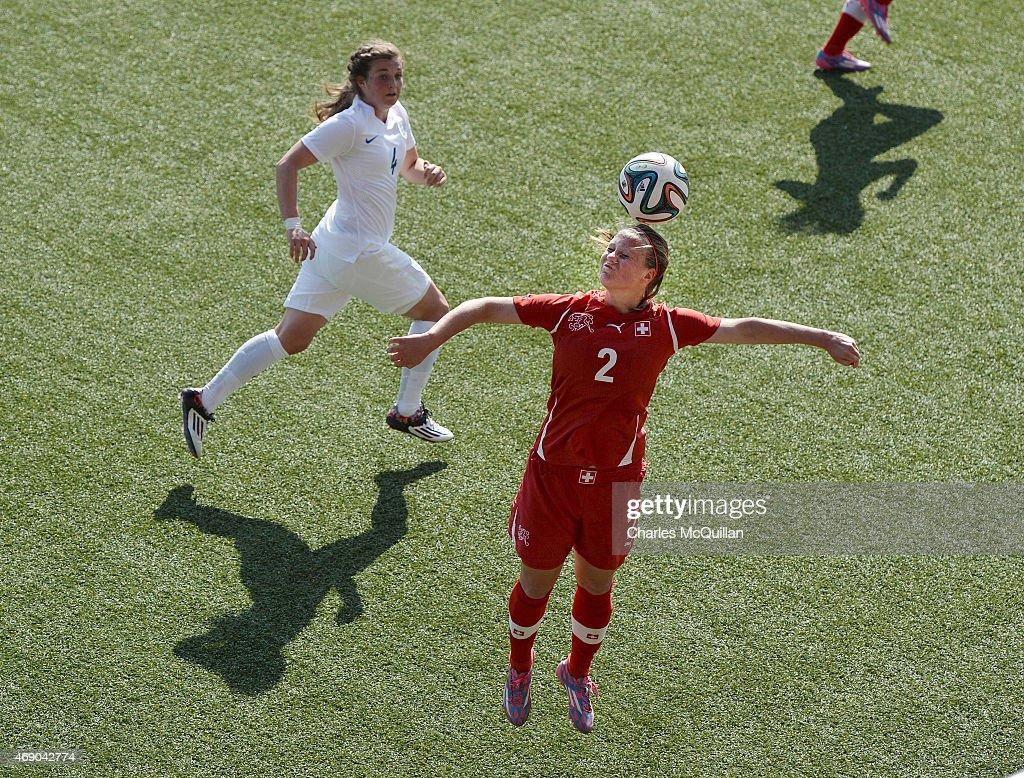 Jodie Brett (L) of England and Chloe Sylvestre (R) of Switzerland during the UEFA U19 Women's Qualifier between England and Switzerland at Seaview on April 9, 2015 in Belfast, Northern Ireland.