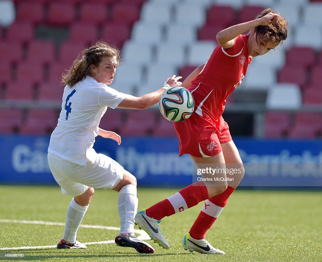 Jodie Brett (L) of England and Cinzia Zehnder (R) of Switzerland during the UEFA U19 Women's Qualifier between England and Switzerland at Seaview on April 9, 2015 in Belfast, Northern Ireland.