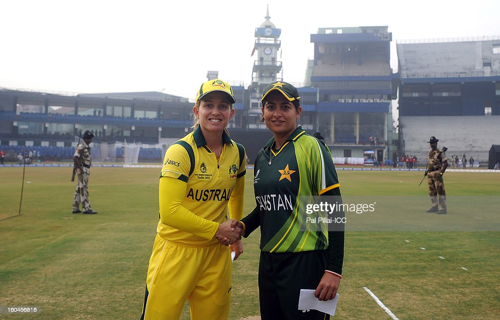 Jodie Fields captian of Australia (L) and Sana Mir captain of Paksitan pose together during the toss before the start of the second match of ICC Womens World Cup between Australia and Pakistan, played at the Barabati stadium on February 1, 2013 in Cuttack, India.