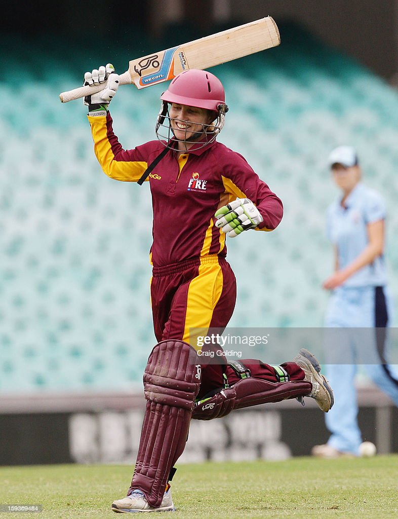 Jodie Fields celebrates on scoring a century during the WNCL Final match between the NSW Breakers and the Queensland Fire at the Sydney Cricket Ground on January 13, 2013 in Sydney, Australia.