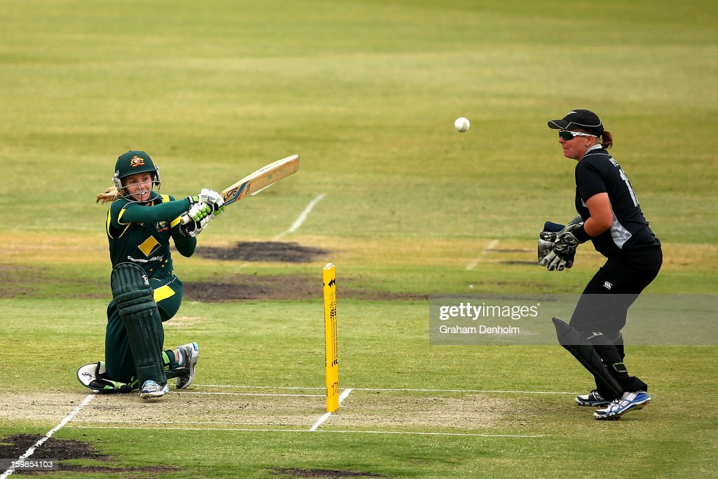 Jodie Fields of Australia (L) bats during the Women's International Twenty20 match between the Australian Southern Stars and New Zealand at Junction Oval on January 22, 2013 in Melbourne, Australia.